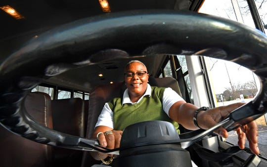 Traci Garrett is a Metro schools bus driver who often goes above and beyond for the students she drives every day. One of the biggest ways – she tries to encourage her middle schoolers to get good report cards by rewarding them with $5 gift cards to places like Dollar Tree, Walmart and McDonalds Friday Dec. 6, 2019, in Nashville, Tenn.