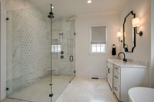 Curbless showers, glassed-in instead of curtained, tile inlay details and freestanding tubs are some of the common master bathroom trends.