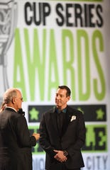 Jim France, NASCAR chairman and CEO, presents Kyle Busch with the Champion Trophy Award during the 2019 NASCAR Cup Series Awards at Music City Center.