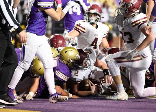 ECS's Jacob Hatcher (2) lands in the end zone for a touchdown in the fourth quarter against CPA in the Division II-AA high school football championships at Tucker Stadium in Cookeville, Tenn., Thursday, Dec. 5, 2019.