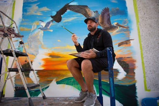 J.J. Stinchcomb talks about his new mural based on local wildlife, Thursday, Dec. 5, 2019, at the Marco Island Historical Museum.