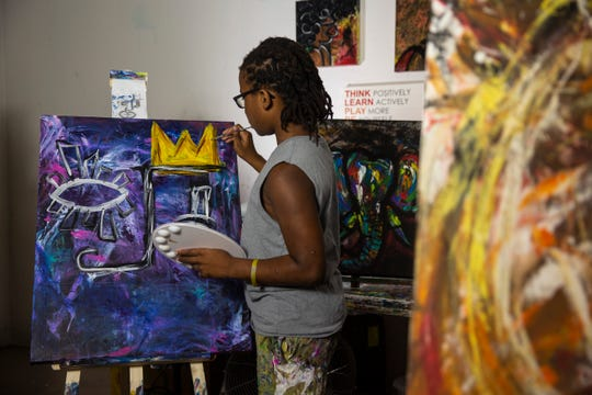 Nalin Isme, an 11-year-old artist, works on his paintings at home on Thursday, December 5, 2019, in Estero.