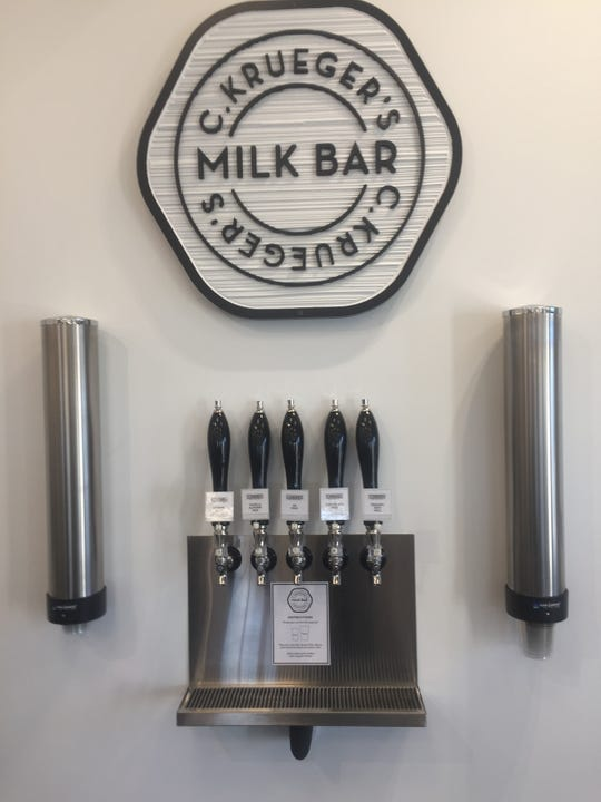 The serve-yourself milk bar will include seasonal offerings, such as hot cider and eggnog.