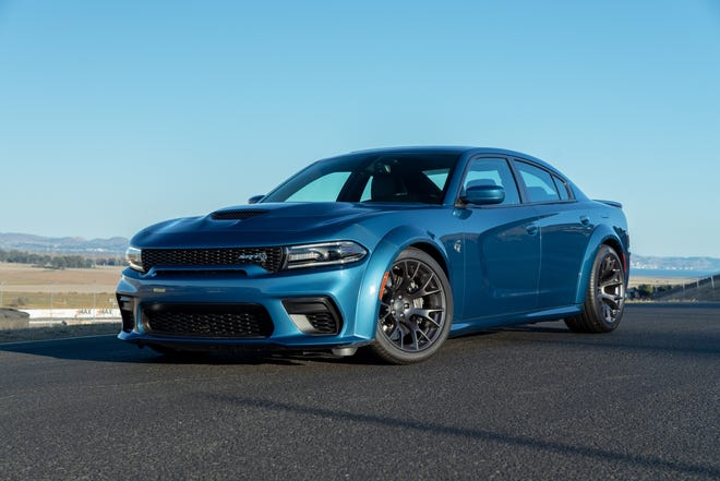 The 2020 Dodge Charger Scat Pack is powered by the 6.4-liter (392 cubic inches) Hemi V8 engine that delivers 485 horsepower and 475 pound-feet of torque, enough to hit 60 miles an hour in 4.3 seconds and the quarter-mile in 12.4 seconds.