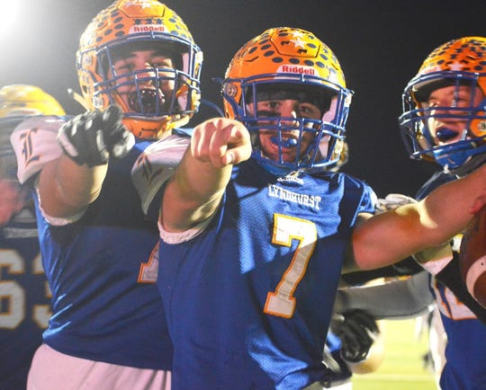 Lyndhurst quarterback Anthony Lembo (7) and his teammates celebrating after a touchdown against Parsippany.