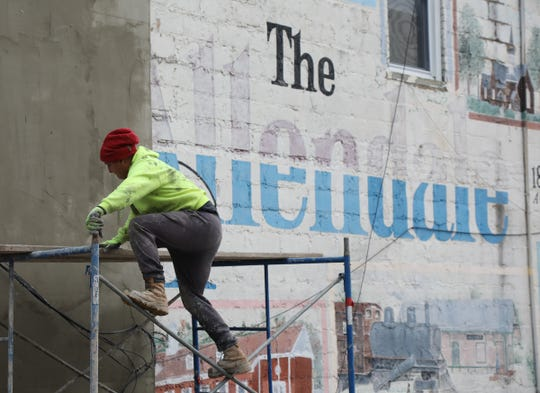 A building housing several store fronts is being refaced on West Allendale Ave. in downtown Allendale and a mural on the side of the building from 1994 is being covered.