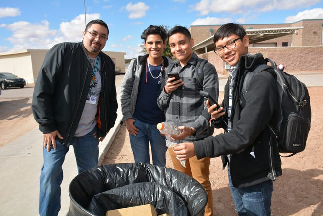 Saul Nunez, science teacher at Santa Teresa High, poses with students Joshua Cervantes, Ethan Garcia and Giovanni Fuentes.