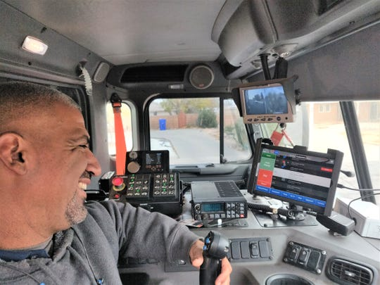 Heavy Equipment Operator Sergio Saenz checks his route through the Routeware tablet installed in the cab of his solid waste truck. The new smart technology documents every stop, allowing better and more efficient service to Las Cruces Utilities customers.