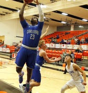 Carlsbad's Shamar Smith goes for a layup against Los Lunas on Dec. 5, 2019. Smith scored 18 points and Carlsbad won, 69-53.
