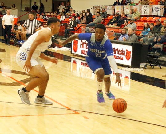 Shamar Smith drives the lane in the second half of Thursday's game against Los Lunas. Smith scored 18 points for Carlsbad, with 14 coming in the second half.