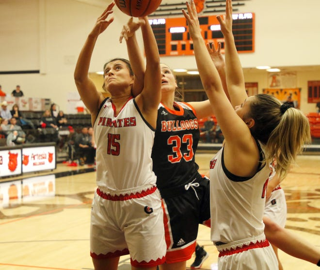 Grants' Shaylee Montoya (15) and Artesia's Kaylee Wagner (33) battle for a rebound during their game on Dec. 5, 2019. Grants defeated Artesia, 43-32.