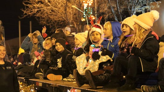 Children involved in Farmington Gymnastics Academy at Farmington's annual Christmas Parade in Farmington on Dec. 5, 2019.
