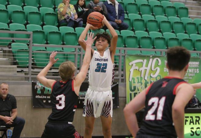 Shiprock's Shannon Dale makes a 3-pointer against Durango during the Marv Sanders Invitational boys basketball tournament Thursday at Scorpion Arena in Farmington.