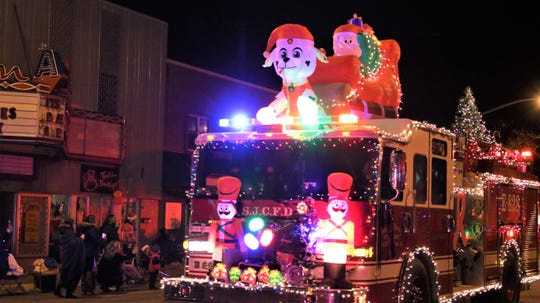 A San Juan County Fire Department truck ringed with holiday lights at Farmington's annual Christmas Parade in Farmington on Dec. 5, 2019.