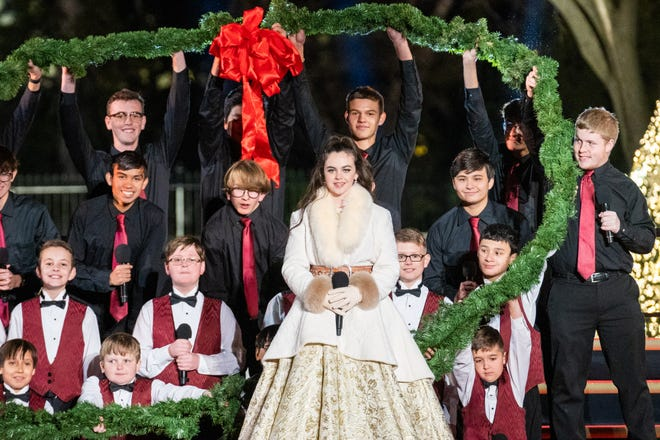 """Winner of """"The Voice"""" season 15 singer Chevel Shepherd is seen on stage with other performers at the 2019 National Christmas Tree Lighting Ceremony in Washington."""