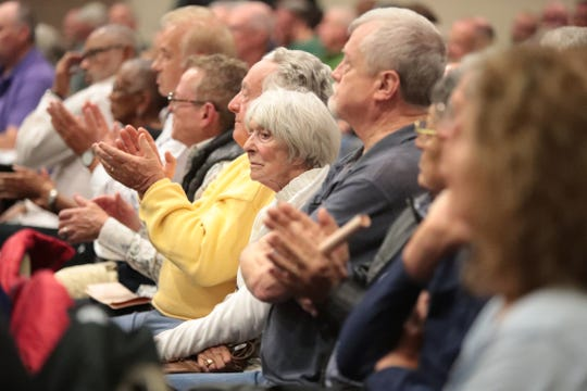 People listen during a special meeting regarding the downtown arena at the Palm Springs Convention Center in Palm Springs, Calif., on December 5, 2019.