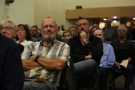 A man scowls Thursday night as he listens to officials discuss the proposed downtown Palm Springs arena during a public hearing at the Palm Springs Convention Center.