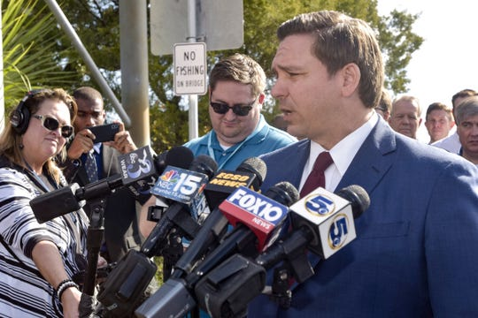 Governor Ron DeSantis addresses media at a press conference outside of NAS Pensacola regarding a shooting that happened on Friday, Dec. 6, 2019