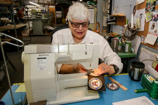 Owner Irma Speed stitches patches at her Wings & Things Monogramming location on W. Navy Boulevard on Friday, Dec. 6, 2019. Wings & Things, open since 1987, began as Irma's Monogramming in 1976, and has two locations on Navy Blvd. The business happily provides sewing, embroidering, and monogramming for the area's military community, including the Blue Angels.