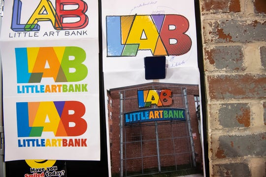 The logo for the Little Art Bank was a collaborative process and went through several variations before a final design (bottom right) was reached.