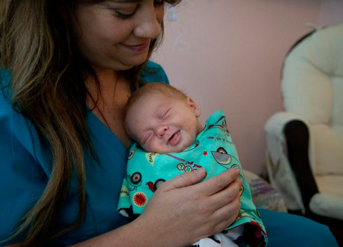 Certified nurse's assistant, Laura Stulting, cares for Jacob's Hope's first infant on Dec. 6, 2019. Jacob's Hope is a care facility for infants who were born substance-exposed. The two week old's mother was on methadone and in a medically assisted program.