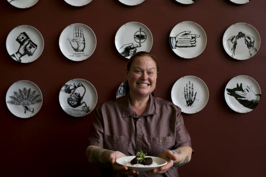 FnB chef and co-owner Charleen Badman holds falafel at FnB restaurant in Scottsdale on Dec. 3, 2019.