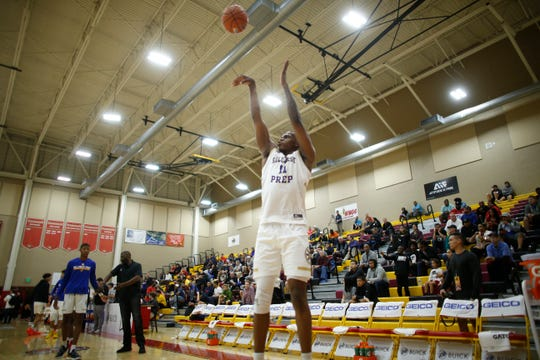 Hillcrest Prep's Michael Foster (11) shoots in warmups during the 2019 Hoophall West basketball tournament at Chaparral High School in Scottsdale, Ariz. on Dec. 5, 2019.