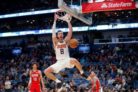 Phoenix Suns forward Frank Kaminsky (8) dunks during the second half of the team's NBA basketball game against the New Orleans Pelicans in New Orleans, Thursday, Dec. 5, 2019. (AP Photo/Gerald Herbert)
