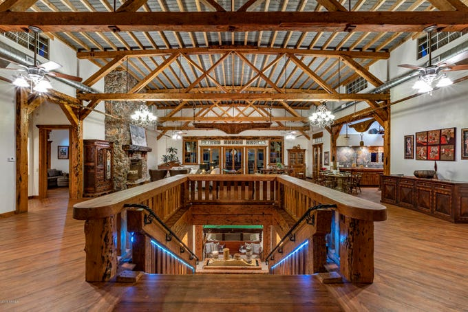 "A look inside the home, featuring the historic wooden beams and ""shipworm wood"" features."