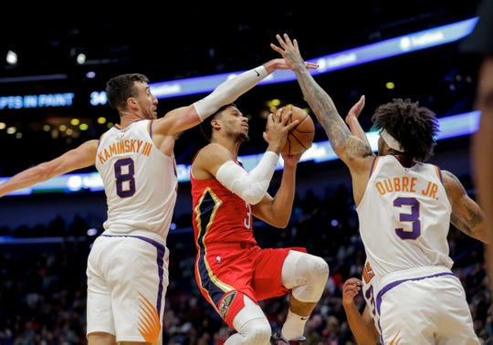 Dec 5, 2019; New Orleans, LA, USA; New Orleans Pelicans guard Josh Hart (3) is fouled by Phoenix Suns forward Frank Kaminsky (8) as forward Kelly Oubre Jr. (3) assists during the second quarter at the Smoothie King Center. Mandatory Credit: Derick E. Hingle-USA TODAY Sports