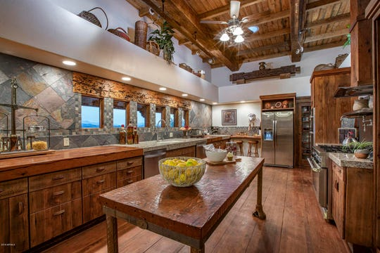 The kitchen features counters crafted from a historic bowling alley and solid wood flooring.