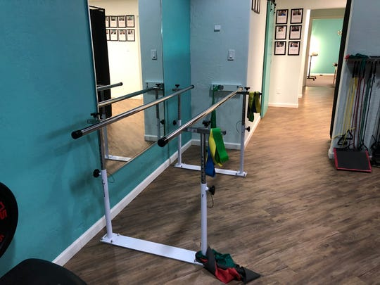 Revive Physical Therapy & Wellness was more like a gym than a doctor's office. Workout equipment lined the mirrored walls. There were weights, colorful resistance bands and foam rollers.