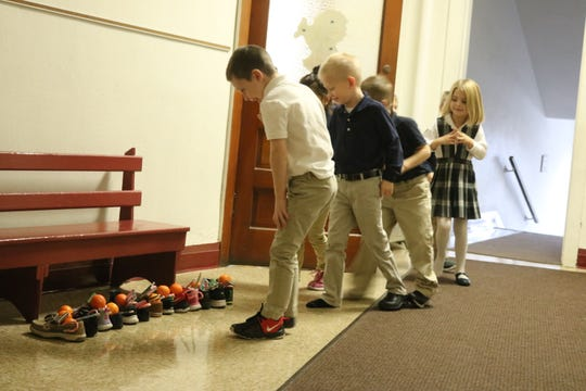 Kindergarten students at Immaculate Conception School on Friday were surprised to find a few presents left in their shoes.