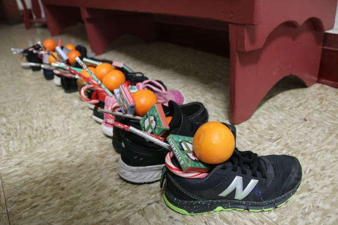 Immaculate Conception School continued the tradition of leaving out shoes for jolly old Saint Nicholas, who left them a few surprises for students on Friday morning.