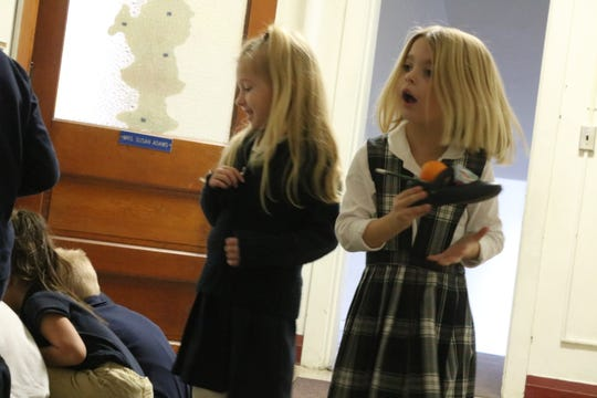 Kindergarten students at Immaculate Conception School on Friday were surprised to find a few presents left in their shoes, a tradition of none other than jolly old Saint Nicholas.