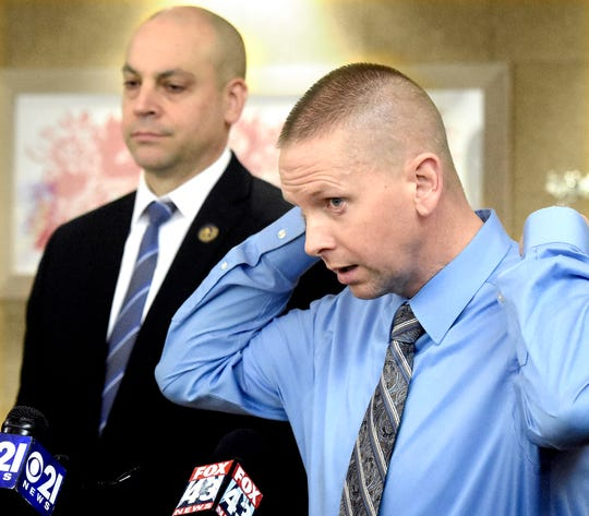 West Manchester Township Detective Sean Conway describes a second suspect, Anu-Malik Johnson, while speaking at a press conference with York County District Attorney Dave Sunday, left, regarding the investigation into Monday's fatal Regal Cinema shooting Friday, Dec. 6, 2019. Police say Johnson is potentially armed and dangerous. Bill Kalina photo