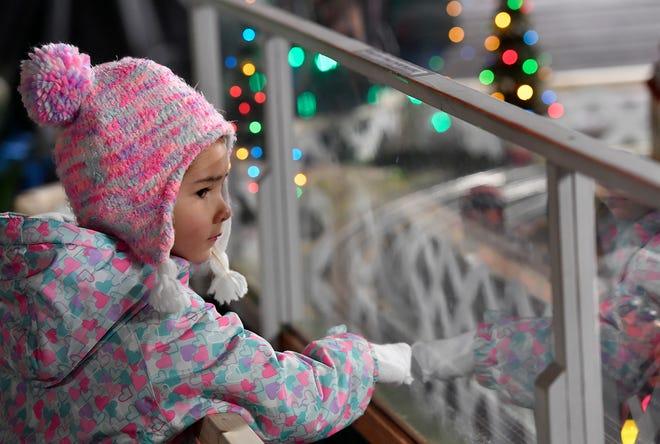 Kaia Turnbaugh, 4 of York,  watches trains at Christmas Magic, Thursday Dec. 5 , 2019. John A. Pavoncello photo