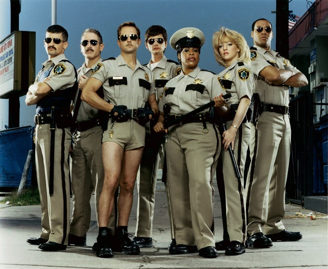 """Robert Ben Garant, left, Carlos Alazraqui, Thomas Lennon, Kerri Kenney, Niecy Nash, Wendi McLendon-Covey and Cedric Yarbrough were known to improvise their way through the spoof """"Reno 911!,"""" which is set to make a comeback on the streaming service, Quibi, in 2020."""