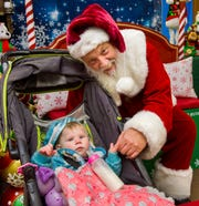 One-year-old Maea Terry checks in with Santa.