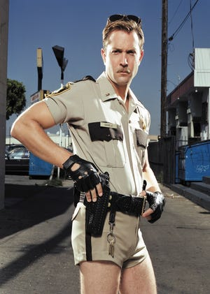 Lt. Jim Dangle, played by Thomas Lennon, in his trademark hot pants is expected to return to Reno 911! as it makes its comeback on the streaming service, Quibi, in 2020.