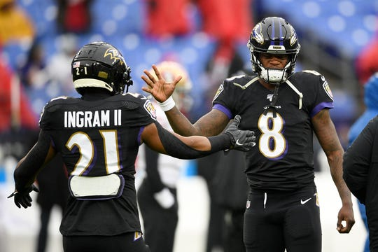 Baltimore Ravens quarterback Lamar Jackson (8) and running back Mark Ingram have dominated defenses all season.