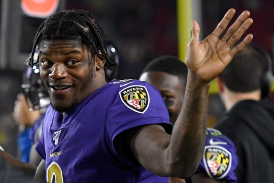 Lamar Jacksonof the Baltimore Ravens waves from the sidelines during a game against the Los Angeles Rams at Los Angeles Memorial Coliseum on Nov. 25 in Los Angeles.
