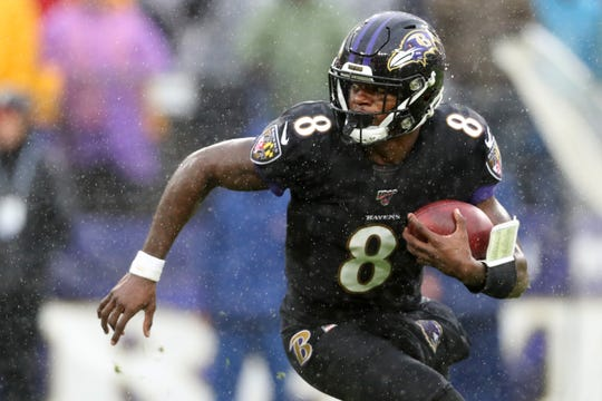 Quarterback Lamar Jackson of the Baltimore Ravens runs with the ball against the San Francisco 49ers in the first half at M&T Bank Stadium on Dec. 1, 2019 in Baltimore.