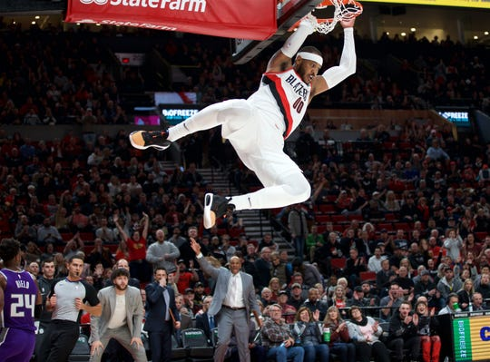 Portland Trail Blazers forward Carmelo Anthony (00) dunks against the Sacramento Kings during the first quarter at the Moda Center on Dec 4, 2019.