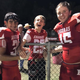 Dillon Brown (middle) with twin brother Sterling (right) and Paco Ramirez at a Rocksprings home football game.