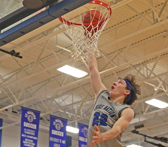 Jesse Greer lays the ball into the basket for Lake View during the Doug McCutchen Memorial Tournament on Friday, Dec. 6, 2019.