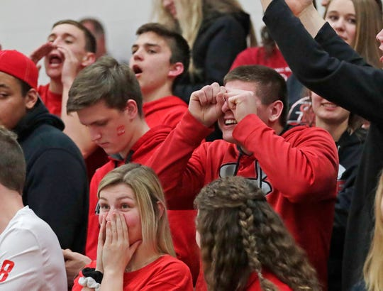Oostburg fans react to a referee call during action with Ozaukee, Thursday, December 5, 2019, in Oostburg, Wis.