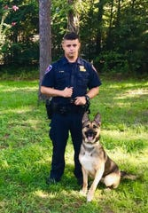 Undated photo of Cpl. Robert Fain and K-9 Officer Maily.