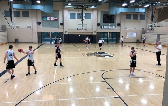 Canyon View basketball stretches and shoots around before practice.