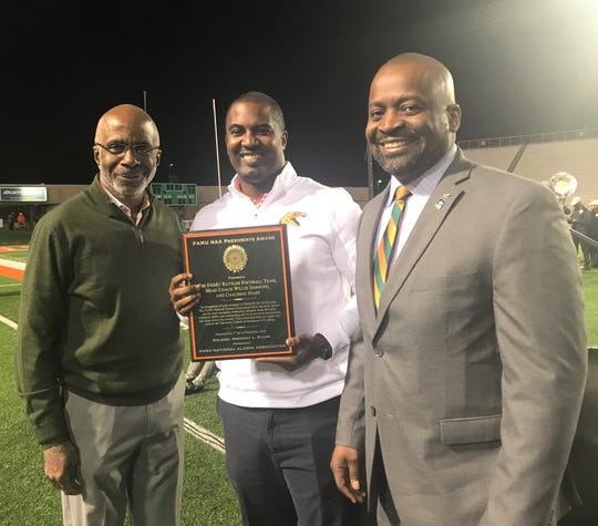 FAMU football head coach Willie Simmons (center) receives and award from the FAMU National Alumni Association. He shares the moment with FAMU President Dr. Larry Robinson (left) and NAA President Col. Greg Clark.